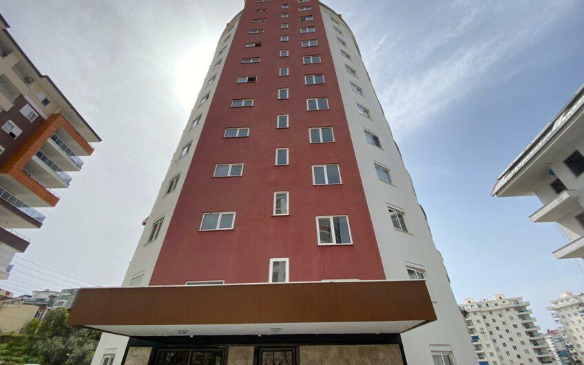 Двухкомнатная квартира по бюджетной цене в районе Махмутлар