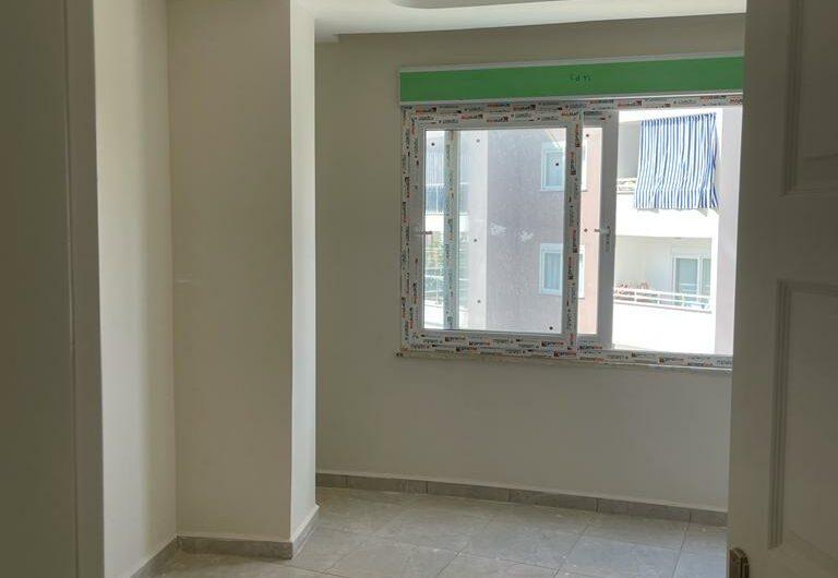 Бюджетная двухкомнатная квартира в новом комплексе в районе Махмутлар